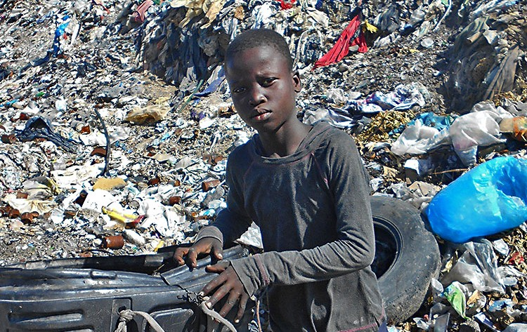 older-boy-garbage-dump-Haiti